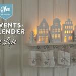 Adventskalender basteln mit beleuchteten Mini-Häusern