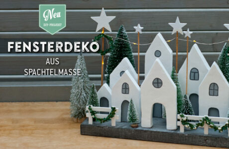 DIY: weihnachtliche Fensterdeko mit kleinen Häuschen aus Spachtelmasse